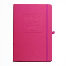 Pink journal saying 'Prayer Changes Things'